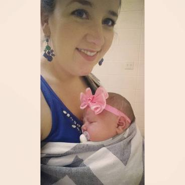 My daughter in my Natibaby wrap conversion ring sling (WCRS) at one week old.